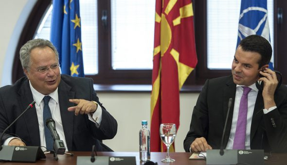 epa05509622 Greek Minister of Foreign Affairs Nikos Kotzias (L) gestures next to his Former Yugoslav Republic of Macedonia counterpart Nikola Popovski (R) during aq prwess conference in Skopje, the Former Yugoslav Republic of Macedonia, 25 August 2016. Nikos Kotzias arrived on a one day visit to Skopje.  EPA/GEORGI LICOVSKI